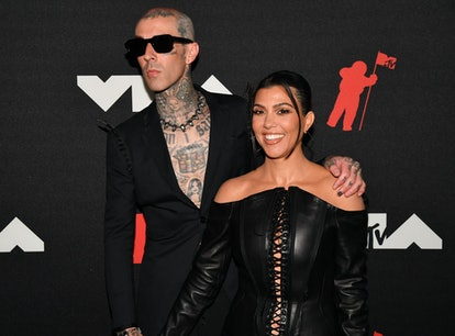 Kourtney Kardashian and Travis Barker's matching name necklaces are proof that PDA can be wholesome.