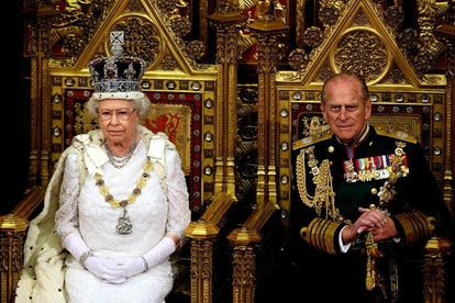 Britain's Queen Elizabeth II (L) sits next to the Duke of Edinburgh at the House of Lords, in Westmi...
