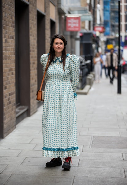 LONDON, ENGLAND - SEPTEMBER 19: A guest is seen wearing dress with print outside Roland Mouret durin...