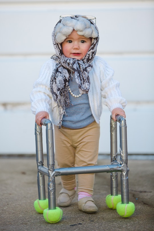 a baby girl dressed up as an old lady for Halloween.