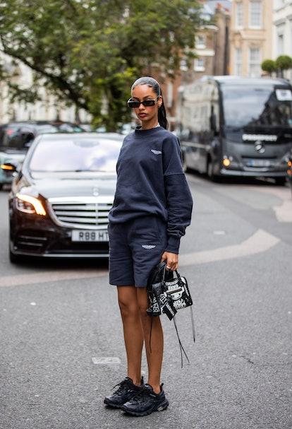 LONDON, ENGLAND - SEPTEMBER 20: A guest is seen wearing grey jumper and shorts outside Paul & Joe du...