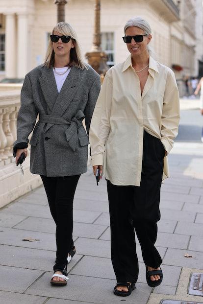 LONDON, ENGLAND - SEPTEMBER 17: Guest at Bora Aksu wearing black trousers, grey jacket, yellow shirt...