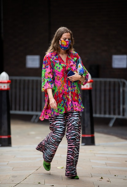 LONDON, ENGLAND - SEPTEMBER 17: A guest is seen outside Rixo during London Fashion Week September 20...