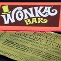 Two of the most iconic film props - a Golden Ticket and Wonka Bar from the 1971 film Willy Wonka & t...