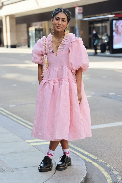 LONDON, ENGLAND - SEPTEMBER 18: Guest wearing pink dress attends yuhan wang at TIKTOK show space dur...