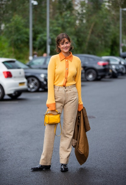 LONDON, ENGLAND - SEPTEMBER 19: A guest is seen wearing yellow Loewe bag outside Rejina Pyo during L...
