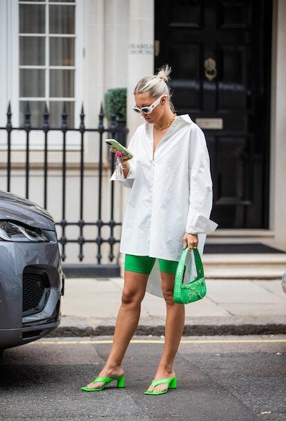 LONDON, ENGLAND - SEPTEMBER 20: Caroline Ebo is seen wearing white button shirt, green bag, shorts o...