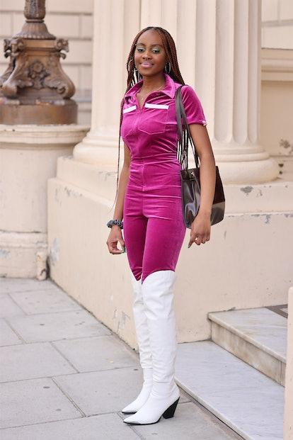 LONDON, ENGLAND - SEPTEMBER 17: Guest at Bora Aksu wearing white knee length boots, purple jumpsuit ...