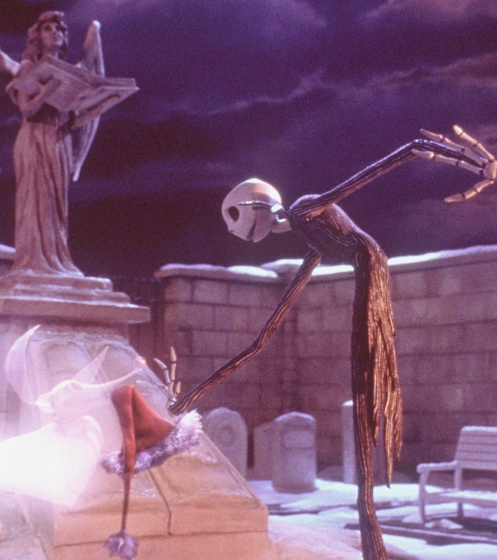 370100 03: Hat in hand, a sadder-but-wiser Jack Skellington gets a boost from his ghost dog, Zero, w...
