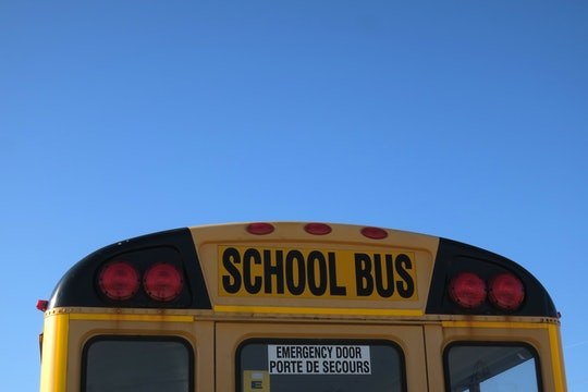 Text on the top of the back of a school bus.