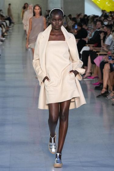 MILAN, ITALY - SEPTEMBER 23: Adut Akech walks the runway at the Max Mara fashion show during the Mil...
