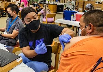 RIVERSIDE, CA - SEPTEMBER 22, 2021: Nurse Francemene Henry administers the Pfizer vaccine to Augusti...