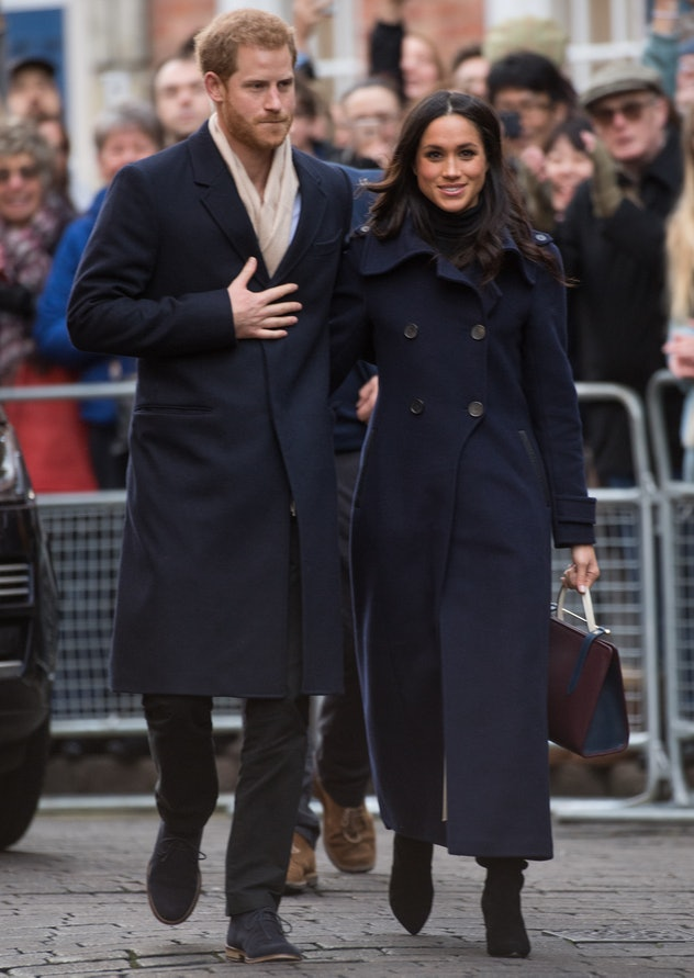Meghan Markle wears a military-style jacket.
