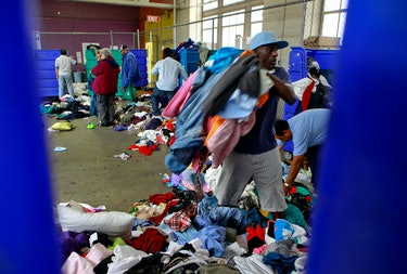 People sort through garbage cans at the Goodwill As-Is store near the corner of 11th and ...