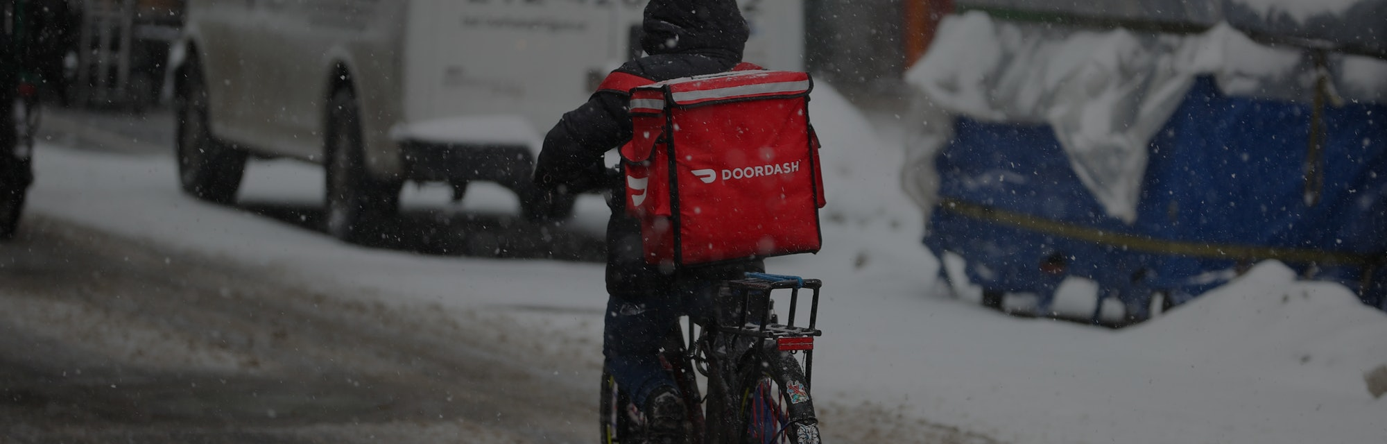 NEW YORK, USA - FEBRUARY 18: A food delivery guy with bicycle is seen as snowfall blankets the Times...