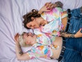 Directly above photo of a young lesbian couple. They are lying on the picnic blanket