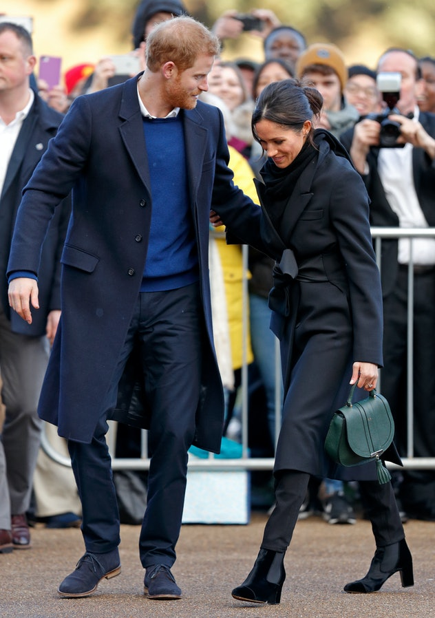 Meghan Markle wraps up in coat and boots.