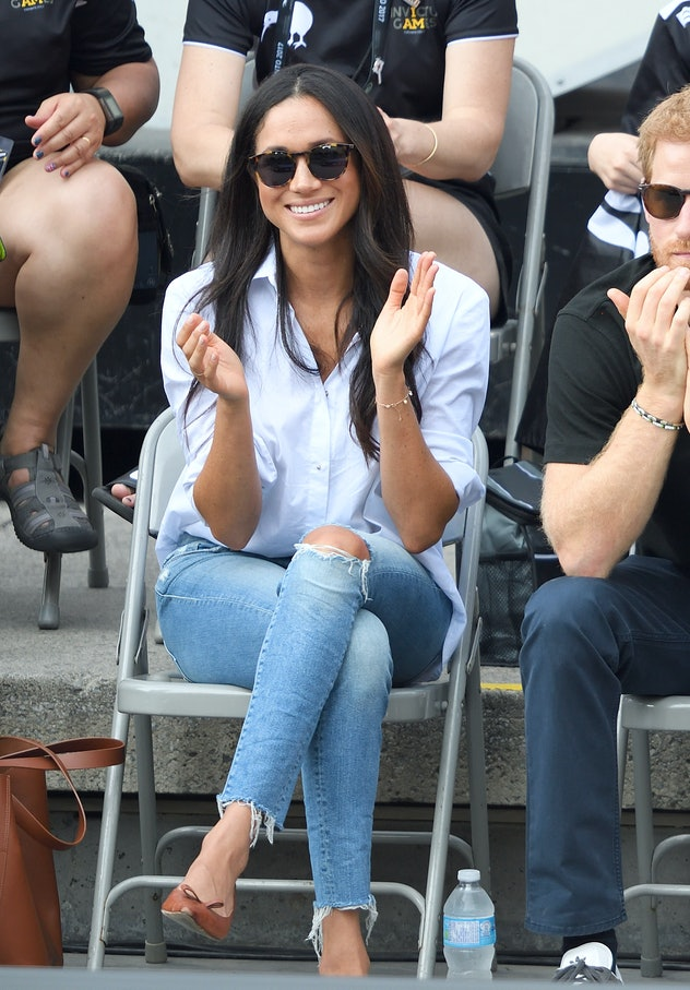 Meghan Markle's transition look of white shirt and jeans.