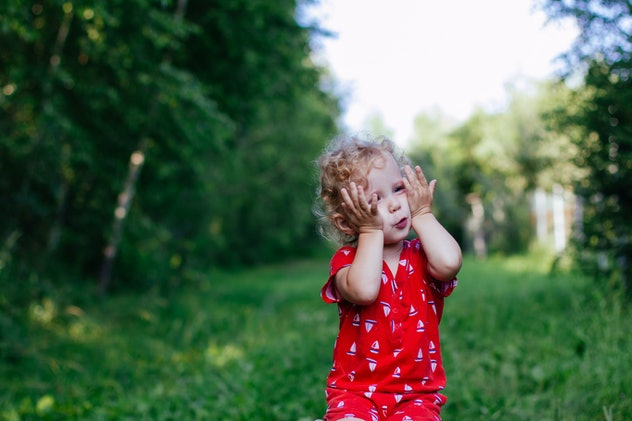 toddler girl wearing red outside