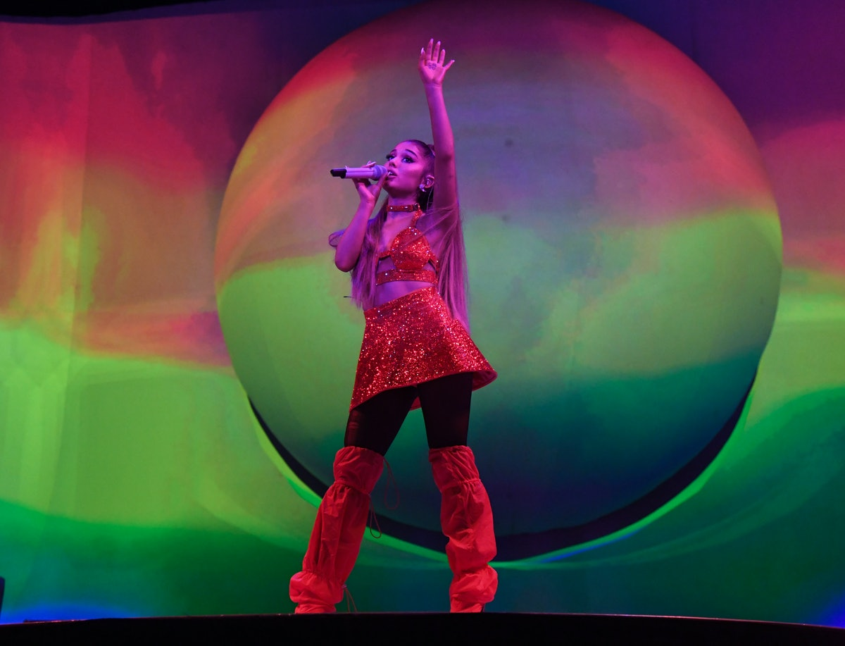 """LONDON, ENGLAND - AUGUST 17: Ariana Grande performs on stage during her """"Sweetener World Tour"""" at Th..."""