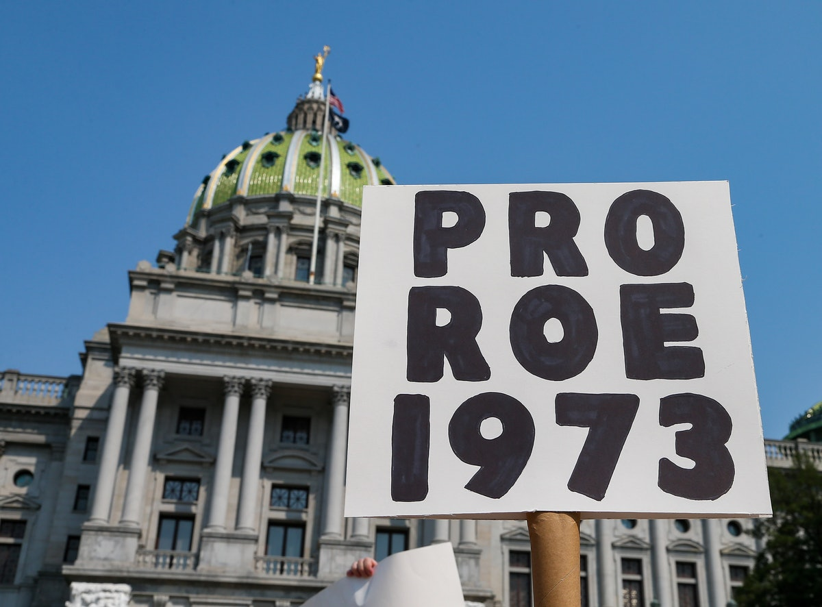 HARRISBURG, UNITED STATES - 2021/09/12: A protester holds a placard in front of the Pennsylvania Sta...