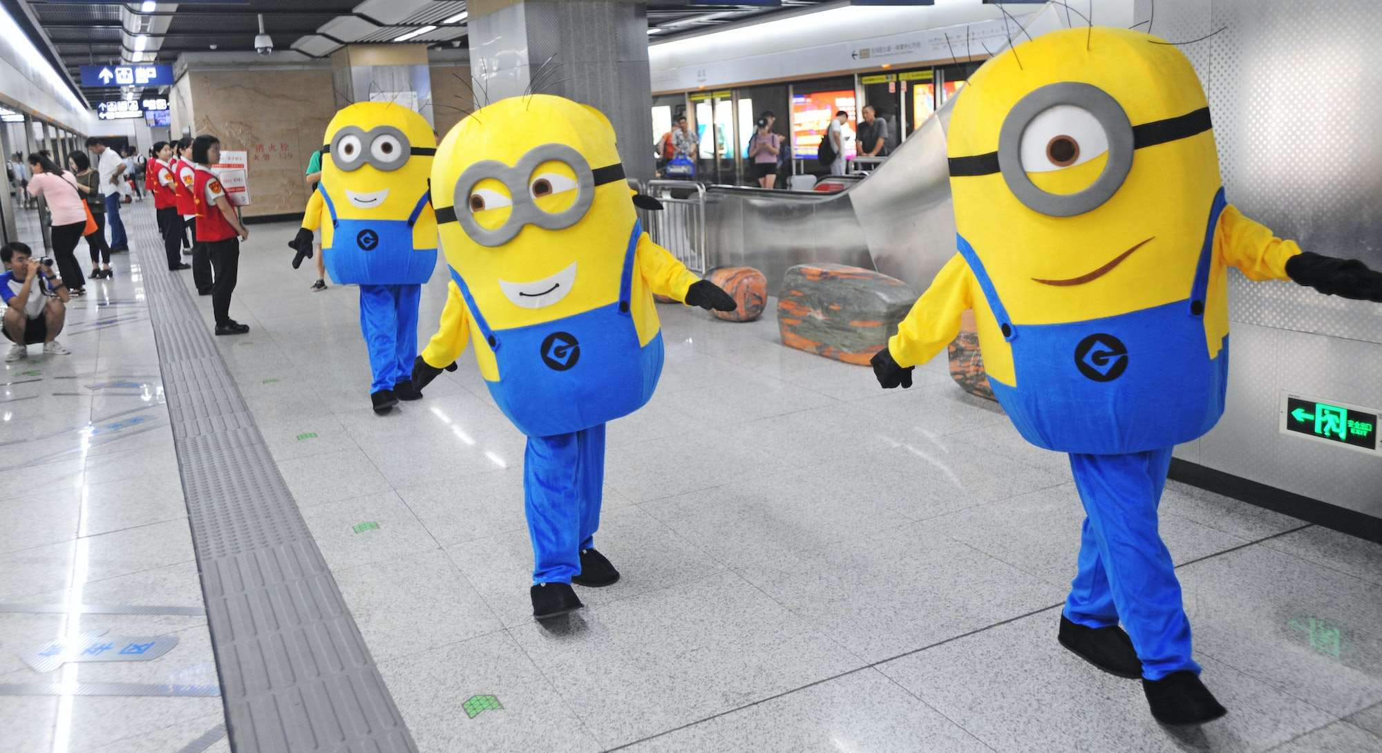 WUHAN, CHINA - AUGUST 13: A volunteer dressed as Minions character greets members of the public at t...