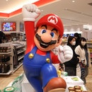 TOKYO, JAPAN - 2021/03/03: Super Mario figurine inside Nintendo Tokyo store in Shibuya. (Photo by St...