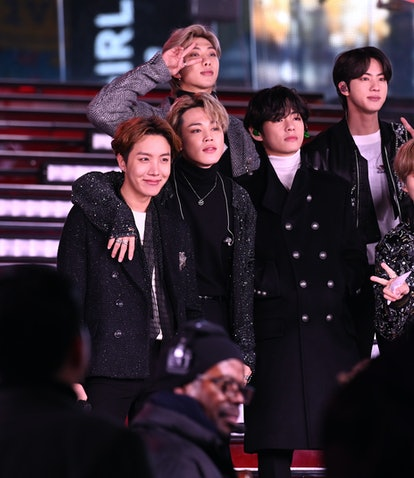NEW YORK, NEW YORK - DECEMBER 31: BTS performs during Dick Clark's New Year's Rockin' Eve With Ryan ...