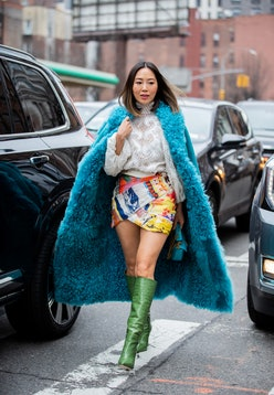 Aimee Song wearing boots outside Zimmermann during New York Fashion Week Fall / Winter in New York C...