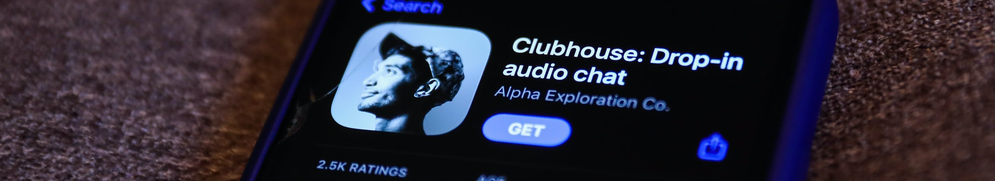 Clubhouse Drop-in audio chat app logo on the App Store is seen displayed on a phone screen in this i...