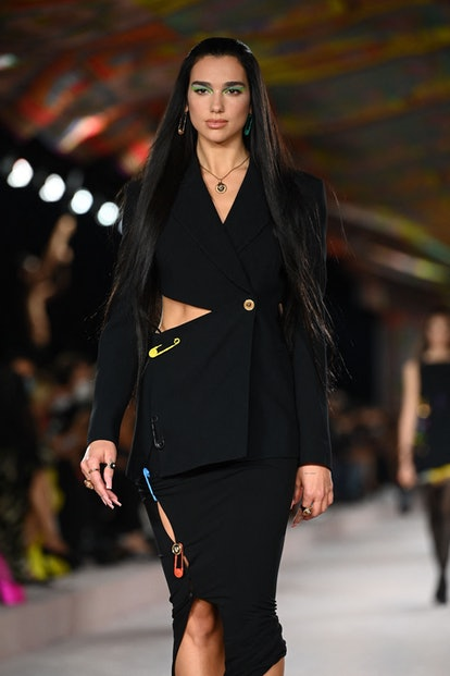 British singer and model Dua Lipa presents a creation for Versace's Women's Spring-Summer 2022 colle...
