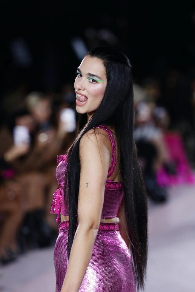 MILAN, ITALY - SEPTEMBER 24: Dua Lipa walks the runway at the Versace fashion show during the Milan ...