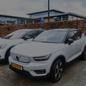 Volkswagen ID.4 and Volvo XC40 Recharge Pure electric crossover SUV cars at an electric vehicle char...