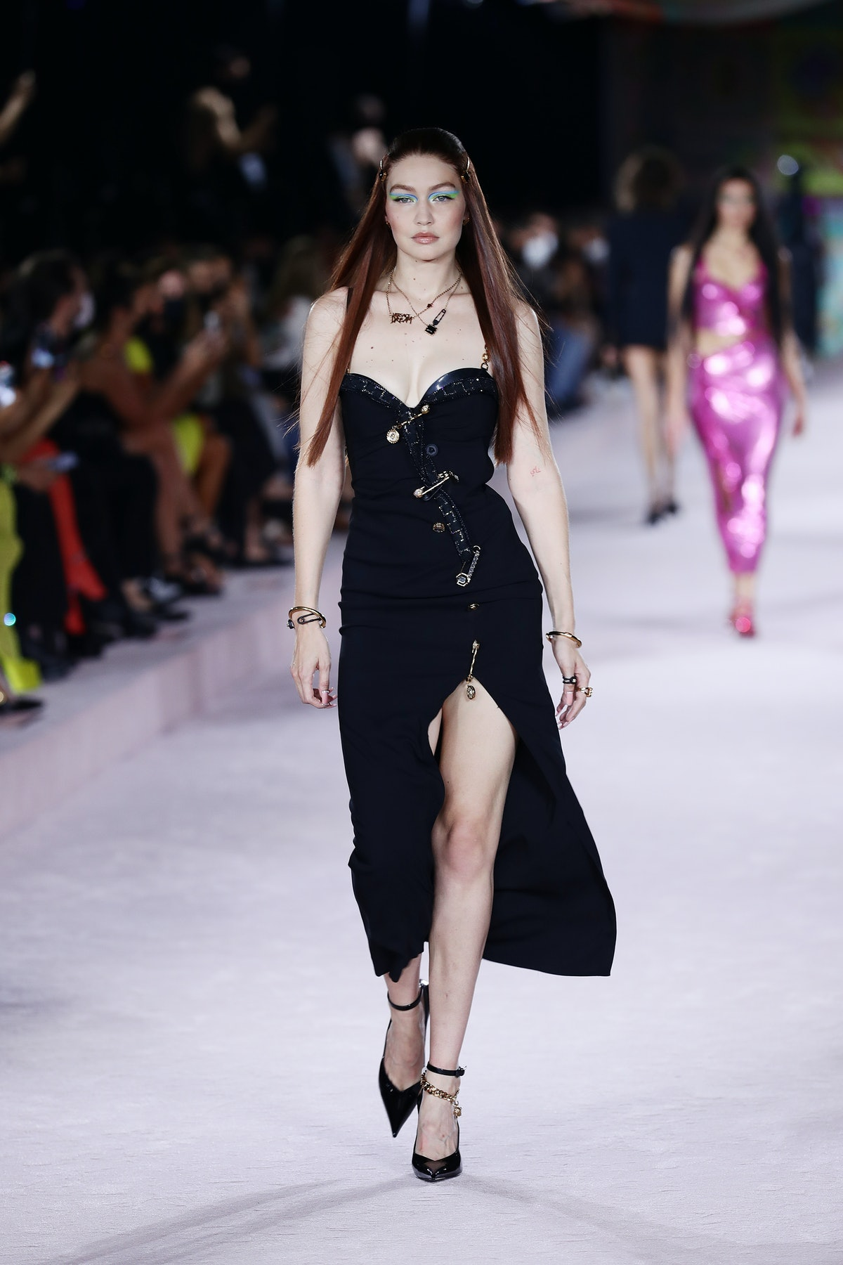 MILAN, ITALY - SEPTEMBER 24: Gigi Hadid walks the runway at the Versace fashion show during the Mila...