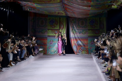 MILAN, ITALY - SEPTEMBER 24: Dua Lipa and fashion designer Donatella Versace acknowledge the applaus...