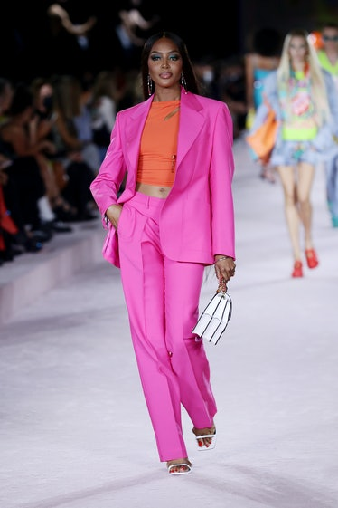 MILAN, ITALY - SEPTEMBER 24: Naomi Campbell walks the runway at the Versace fashion show during the ...