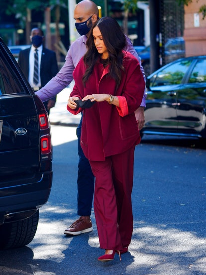 Meghan, Duchess of Sussex wearing all maroon September 24, 2021 in New York City.