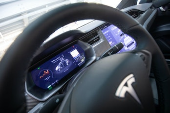 21 October 2020, Hamburg: View into the interior with steering wheel and display of a Tesla Model X ...