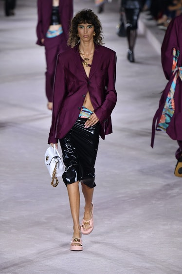 MILAN, ITALY - SEPTEMBER 24: A model walks the runway during the Versace Ready to Wear Spring/Summer...