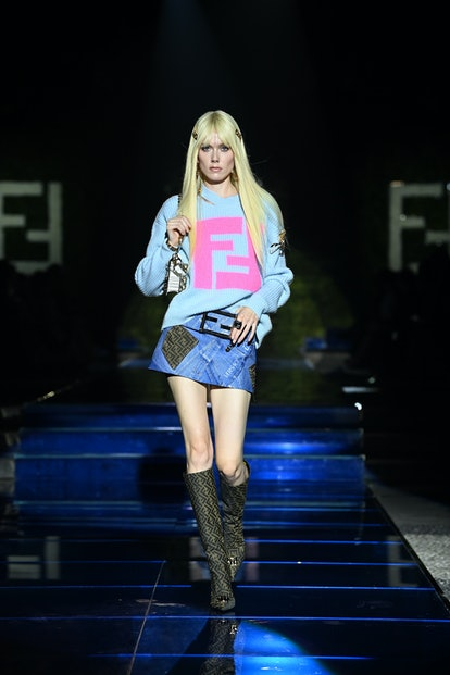 MILAN, ITALY - SEPTEMBER 26: A model walks the runway at the Versace special event during the Milan ...