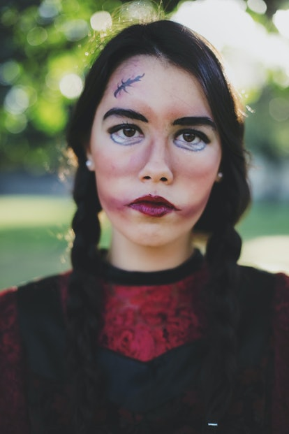 Girl dressed up in doll Halloween eye makeup