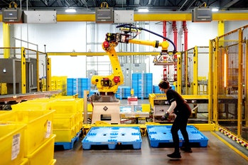 EASTVALE, CA - AUGUST 31: A robot sorts and stacks bins at Amazon fulfillment center in Eastvale on ...