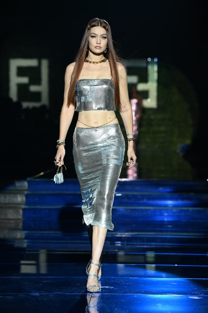 MILAN, ITALY - SEPTEMBER 26: Gigi Hadid walks the runway at the Versace special event during the Mil...