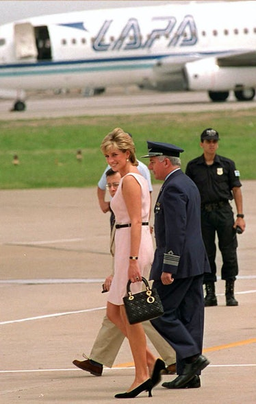 The Princess of Wales, Lady Diana, looks at journalists 26 November as she departs by helicopter for...