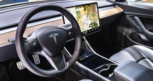 BRUSSELS, BELGIUM - JANUARY 9: Tesla Model 3 compact full electric car interior with a large touch s...