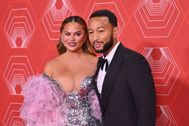 US singer-songwriter John Legend and his wife model Chrissy Teigen attend the 74th Annual Tony Award...