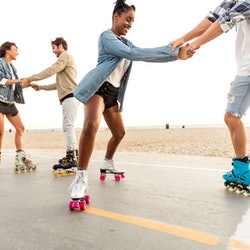 Friends roller skating on the boardwalk in Venice Beach. These are the most open-minded zodiac signs...