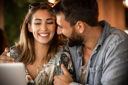 A happy man and a smiling woman on a first date.