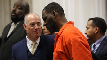 CHICAGO, IL -  SEPTEMBER 17:  Singer R. Kelly appears standing beside his attorney, Steven Greenberg...