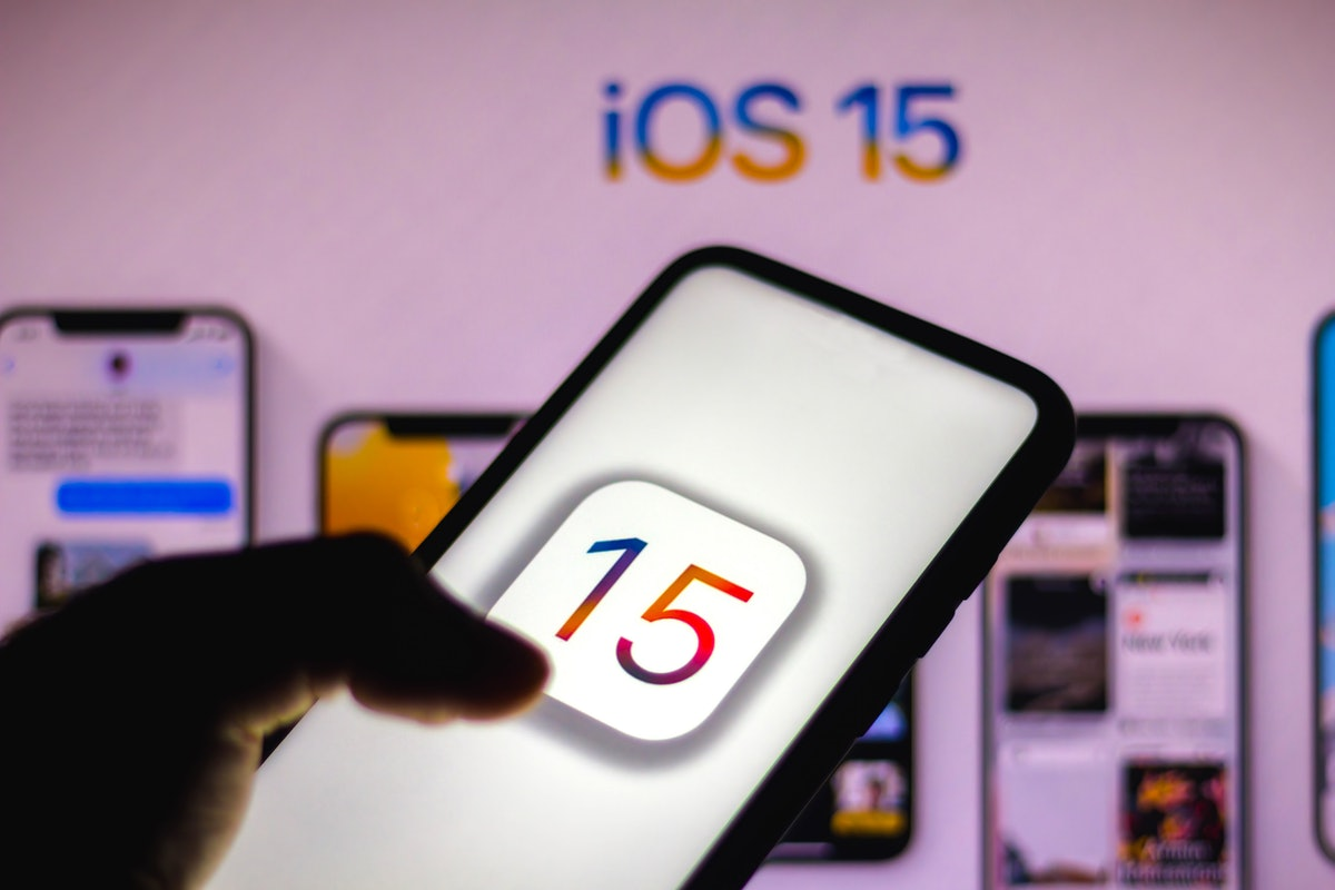 BRAZIL - 2021/06/08: In this photo illustration the iOS 15 logo seen displayed on a smartphone. Appl...
